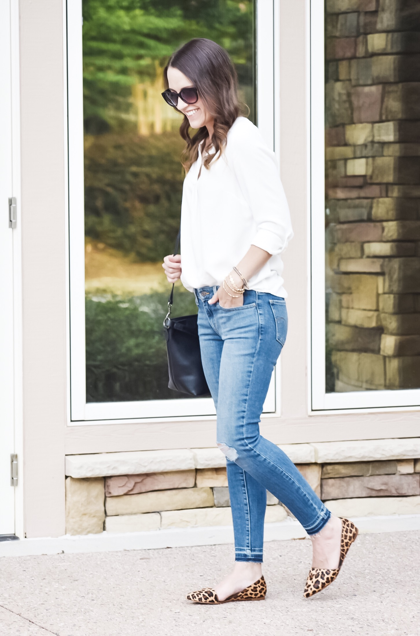 white blouse and skinny jeans